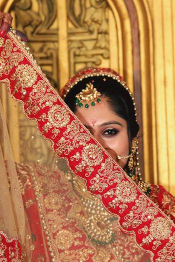 Portrait of bride wearing sari during wedding ceremony