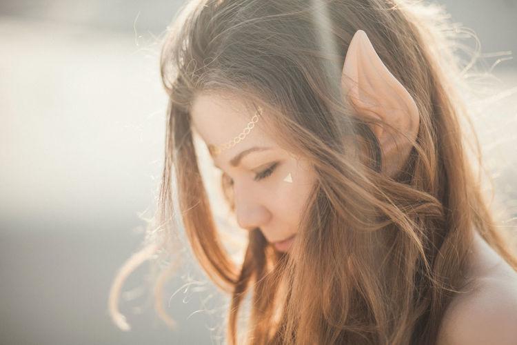 Young attractive woman with elf ears Bright Dreaming Dreamy Elf Elf Ears Fairytale  Festical Flash Tattoo Lifestyles Light Long Hair Magic Magical Portrait Sunshine Sunshine ☀