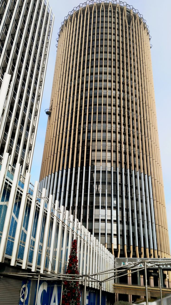 building exterior, architecture, built structure, low angle view, building, office building exterior, city, modern, office, sky, no people, skyscraper, tall - high, day, clear sky, nature, in a row, window, tower, outdoors