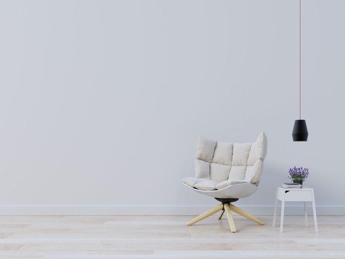 Furniture On Hardwood Floor Against White Wall