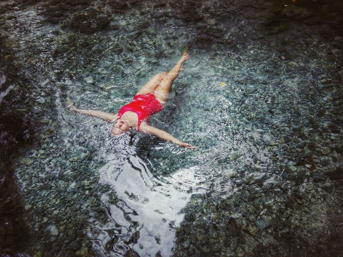 Woman Relaxing In Sea