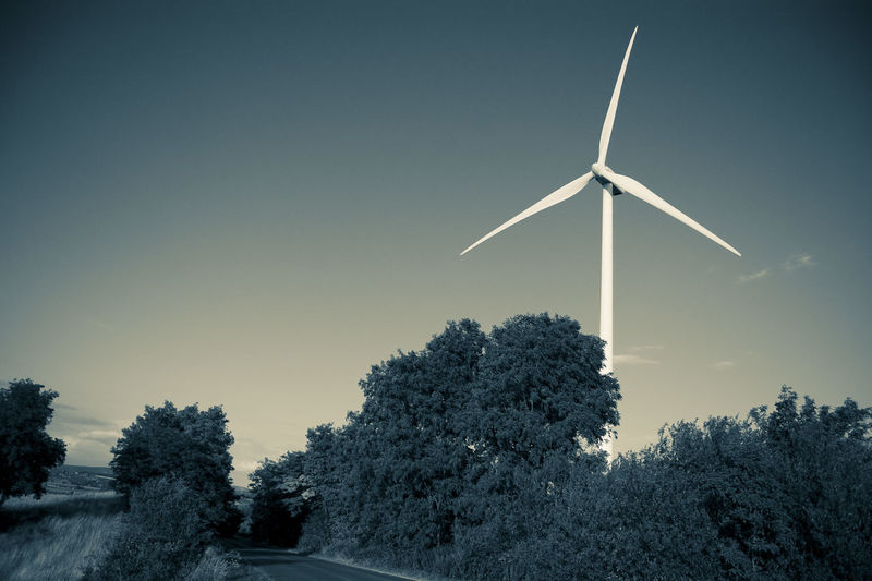 Alternative Energy Environmental Conservation Field With Wind Power Station Green Power Landscape Landscape With Power Station Monochrome Photography Outdoors Power Plant Power Station By Road Technology And Nature Tone Splitting Wind Power Wind Power Generator