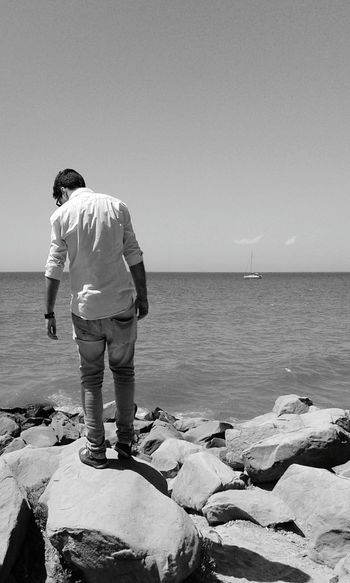 Man in front of the sea Sea Sea And Sky Seaside Black And White Light And Shadow Black And White Photography Cealing Urban Spring Fever The KIOMI Collection Fresh On Eyeem