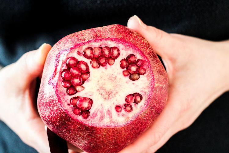Close-up Cross Section Day Focus On Foreground Food Food And Drink Freshness Fruit Healthy Eating Holding Human Body Part Human Hand Indoors  One Person People Pomegranate Pomegranate Seed Real People Red Seed SLICE
