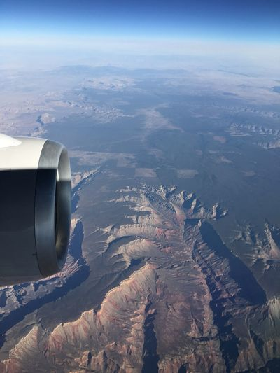 Cropped Image Of Jet Engine Over Landscape