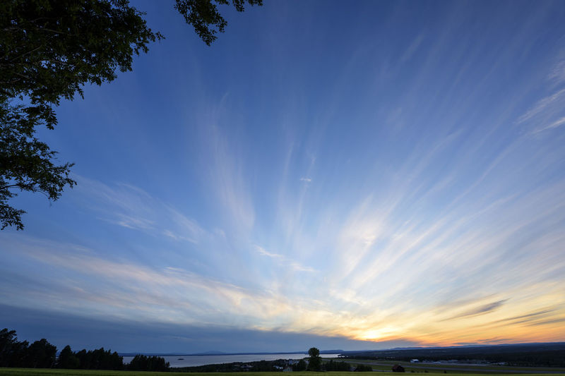 Scenic view of vapor trail in sky during sunset