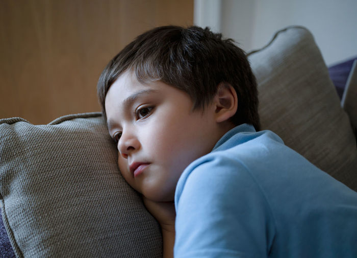 Portrait of boy relaxing at home
