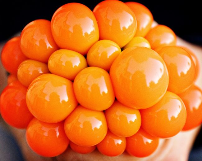 Cropped Hand Squeezing Orange Stress Ball