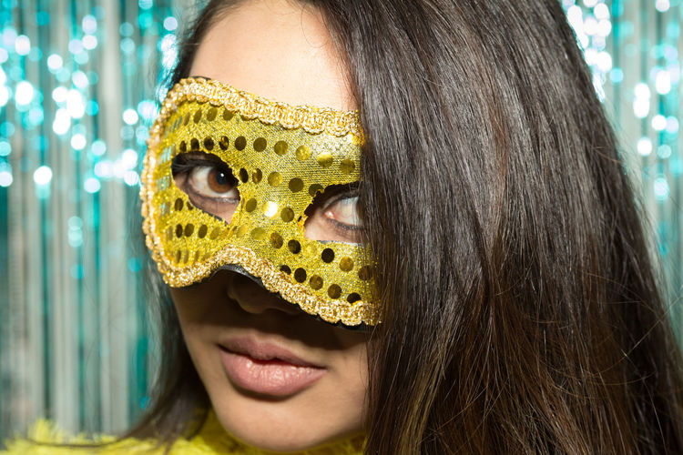 Close-up portrait of young woman wearing mask