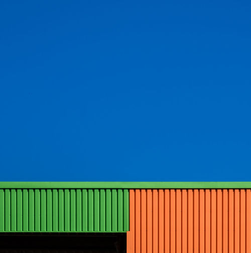 Blueskybuildingdetail Architecture Blue Built Structure No People Fujix_berlin Ralfpollack_fotografie Minimalism Minimal Copy Space Sky Green Color Industry Backgrounds Clear Sky Corrugated Outdoors Pattern, Texture, Shape And Form Pattern