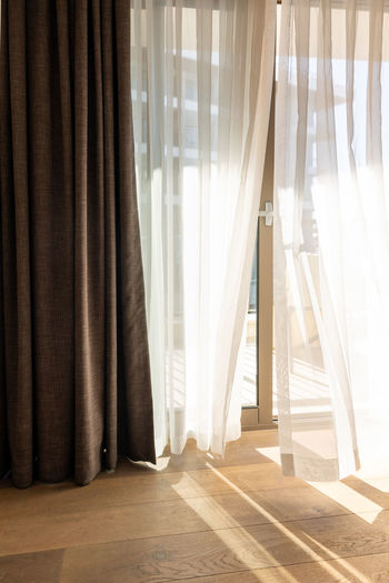 White curtain hanging at home