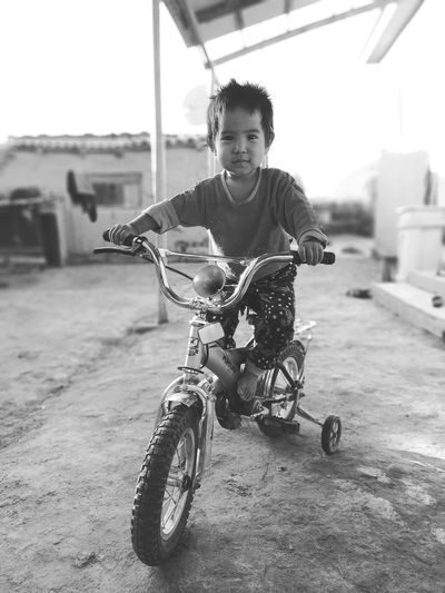 Portrait of boy riding motorcycle