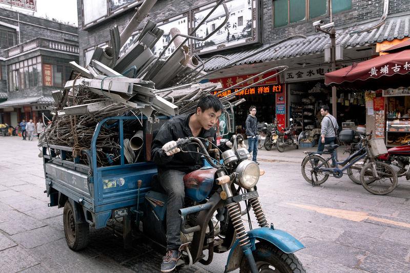 Man riding motorcycle in parking lot