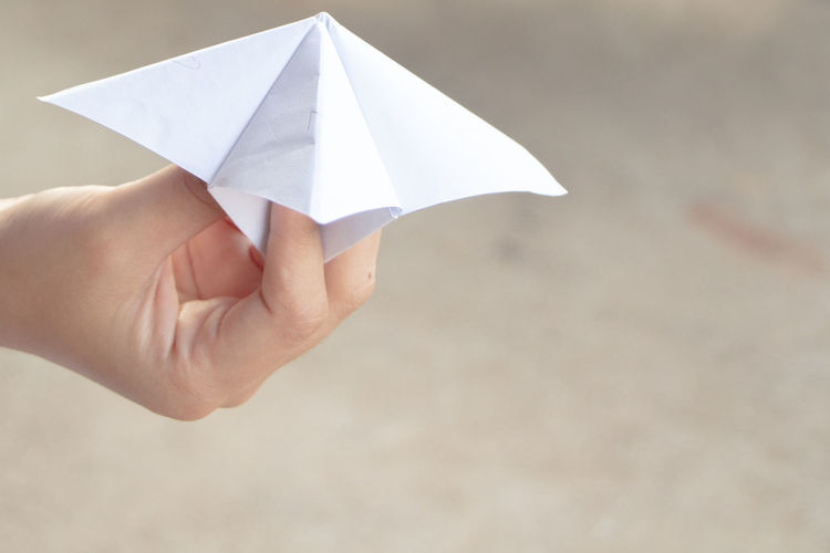 Close-up of hand playing with origami