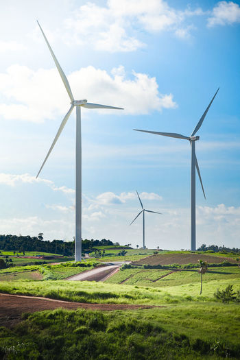 Alternative Energy Cloud - Sky Day Environmental Conservation Field Fuel And Power Generation Grass Green Color Horizon Over Land Industrial Windmill Landscape Non-urban Scene Renewable Energy Scenics Sky Wind Power Wind Turbine Windmill
