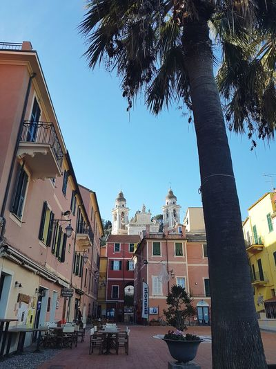 village view Sea Village Travel Destinations Travel Palm Tree No People Pastel Colored Liguria,Italy Church Towers Tranquility Silence Villagescape Old Village Blue Sky