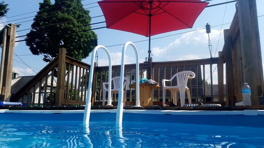 Water Swimming Pool No People Day Sky Outdoors Tree Summer Pool Cooling Off Hot Out Beach Umbrella Poolside Sunshade Lounge Chair Outdoor Chair Deck Chair Pool Party
