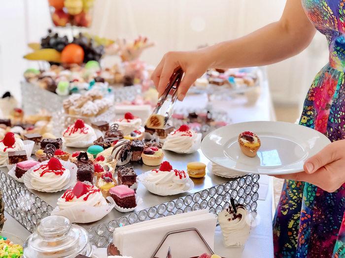 High angle view of woman cake on table
