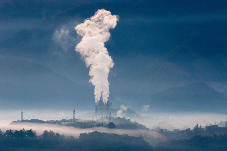 Pollution Factory Industry Smoke - Physical Structure Smoke Stack Sky Day Outdoors Blue Vapor Trail No People Architecture