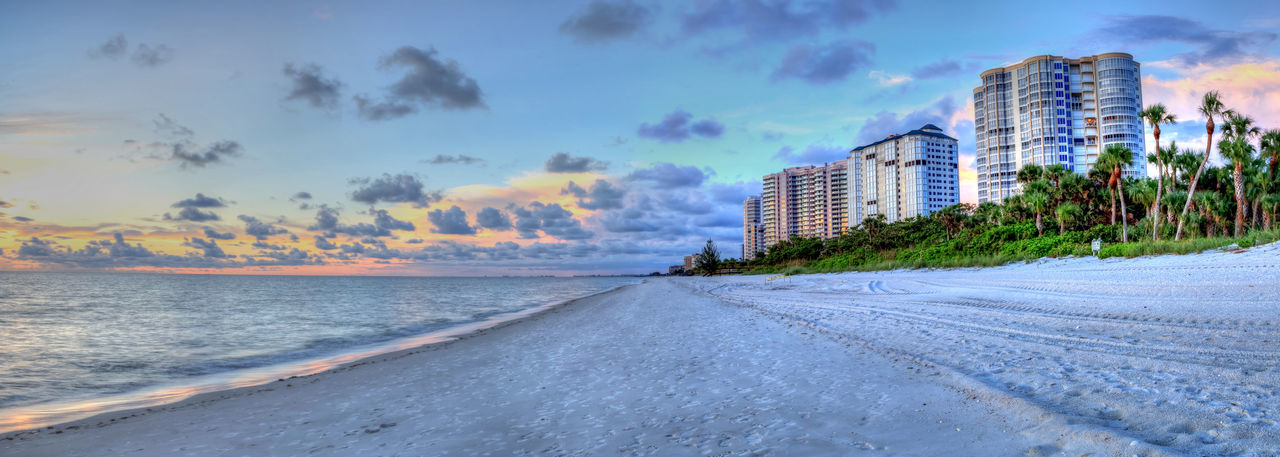 Sunset over the ocean at Vanderbilt Beach in Naples, Florida Coastline Naples Nature Ocean View Panorama Panoramic Panoramic View Sunset And Clouds  Vanderbilt Beach White Sand Beach Beach Beautiy In Nature Dusk End Of Day Florida Florida Life Landscape Panorama View Sea Seascape Sunset Waterfront White Flower