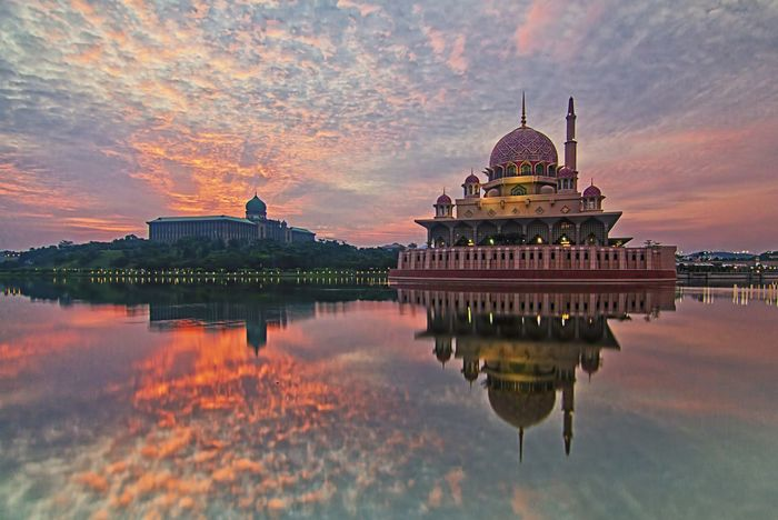 Landscape of Putra Mosque and Perdana Putra During Sunrise Architecture Backgrounds Building Exterior Built Structure Day Dome History Landascape Landscape Masque No People Outdoors Place Of Worship Ramadan  Reflection Religion Sky Spirituality Sunset Travel Destinations Wall Wallpaper Wallpapers Water Waterfront