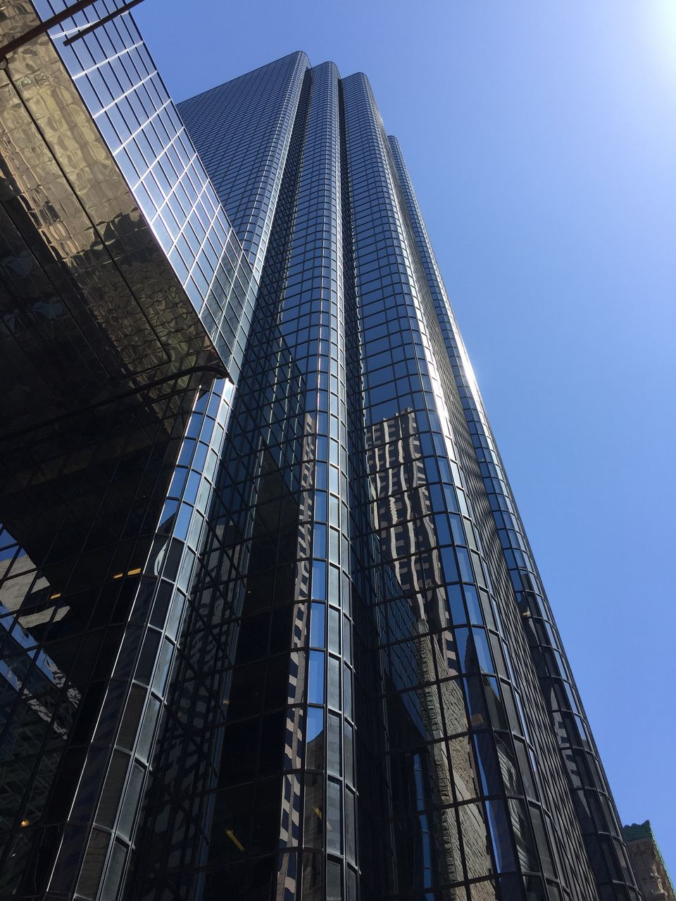 architecture, low angle view, built structure, building exterior, skyscraper, modern, no people, day, city, outdoors, clear sky, sky