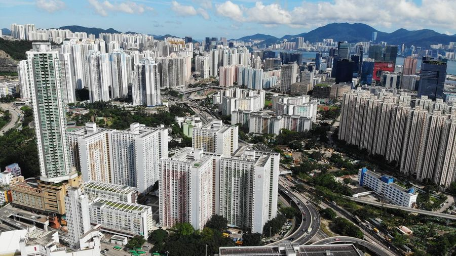 rainbow choi hung public building Aerial View Drone  Dronephotography Public Exterior Housing Development Housing Settlement Choi Hung House Estate Public Housing Estate Hong Kong Modern Skyscraper Office Building Exterior Day Building Cityscape High Angle View Built Structure Architecture Building Exterior City Residential District Tall - High Crowded Outdoors Crowd City Life Sky Skyline