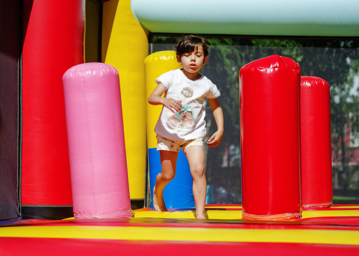 5 years girl playing happy on the city park Boxing Glove Boys Childhood Day Full Length Happiness Leisure Activity Lifestyles One Person Outdoors People Real People Red Sport Young Adult