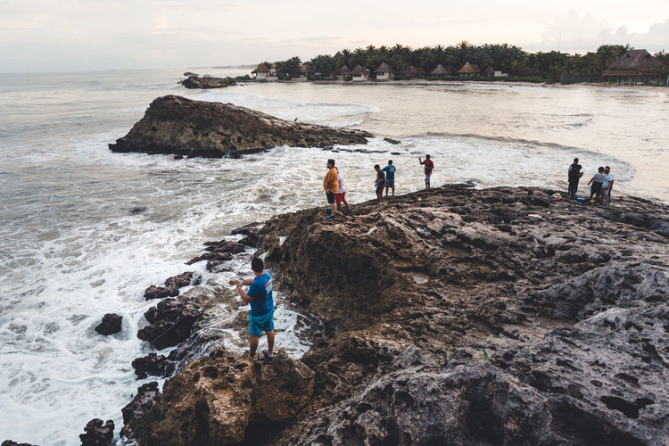 Water Rock Sea Rock - Object Solid Real People Beach Land Leisure Activity Men Group Of People Beauty In Nature Lifestyles Sky Nature People Day Standing Full Length Outdoors