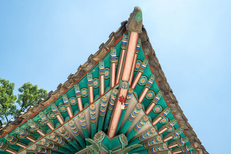 Ornate roof of changdeokgung palace against sky