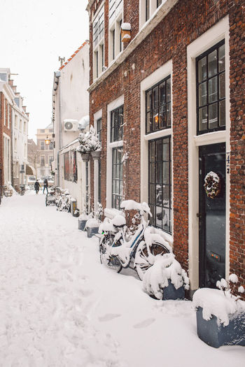 Snow covered buildings in city