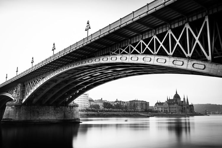 Architecture River Water Nature City Blackandwhite Sky Black And White Bridge Outdoors Transportation Monochrome Long Exposure Waterfront Arch Engineering Connection Arch Bridge Building Exterior Built Structure Bridge - Man Made Structure Tower Government Tourism