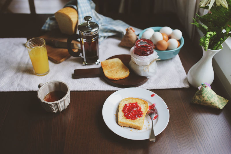 country cottage kitchen with breakfast on wooden table. Toast with jam, farm eggs and coffee Food And Drink Food Drink Table Breakfast Meal Healthy Eating Ready-to-eat No People Indoors  Glass Toast Tea French Press Morning Kitchen Jam Egg Boiled Egg Bread