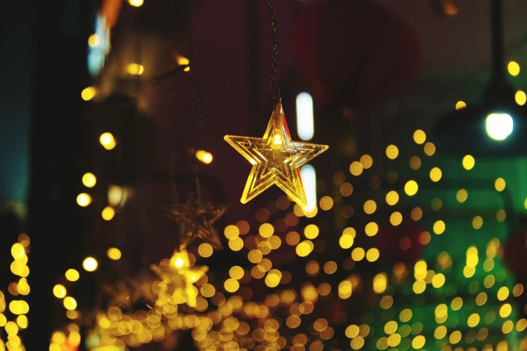 Close-up of gold colored star shape ornament