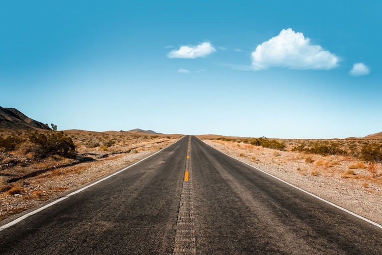Endless expanse . road in the death valley national park, nevada usa