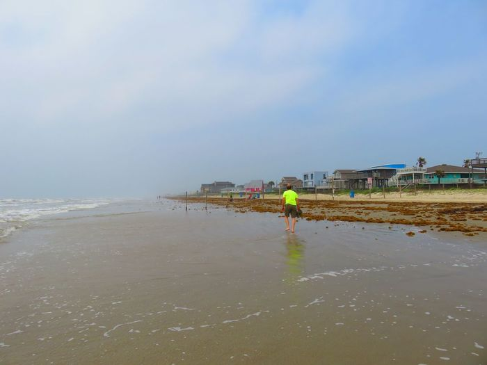 Water Sea Beach Sky Real People Day One Person Outdoors Men Nature Built Structure Lifestyles Beauty In Nature Standing Architecture People Galveston Island  Galveston Beach  Ocean Walking The Beach