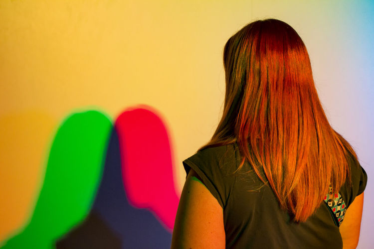Colorful Dual Shadows Of Woman On Wall