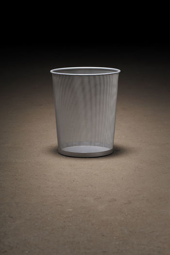 Empty wastepaper basket on dirty concrete floor Indoors  Single Object No People Empty Nothingisordinary Trash Trashcan Waste Basket