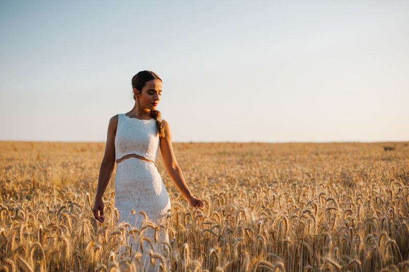 Bride Bridegroom Wedding Wedding Dress Wedding Photography Wedding Ceremony Wedding Day Land Crop  Sky Agriculture One Person Landscape Young Adult Field Beauty Wheat Rural Scene Nature Cereal Plant Adult Standing Women Fashion Plant Beautiful Woman Outdoors Hairstyle