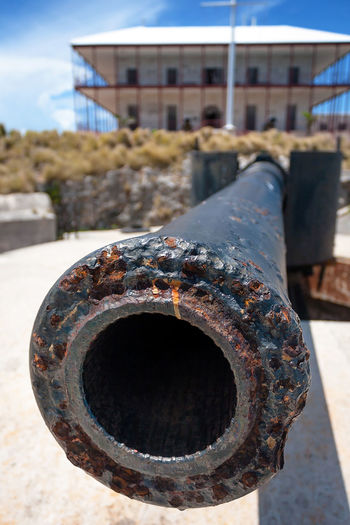 Rusted old Cannon at Royal navy dockyard museum, In bermuda Architecture Bermudas Building Exterior Built Structure Cannon Canon Close-up Day Focus On Foreground Historical Building History Island Metal Military Museum No People Outdoors Royal Navy Dockyard Rusted Rusty Sky Sunlight Water Weapon