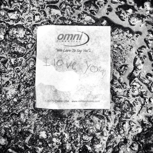 Black And White Parking Lot Loveletters Smile a random note saying I love you stuck to the wet concrete. I think I'll leave it there to share with others today