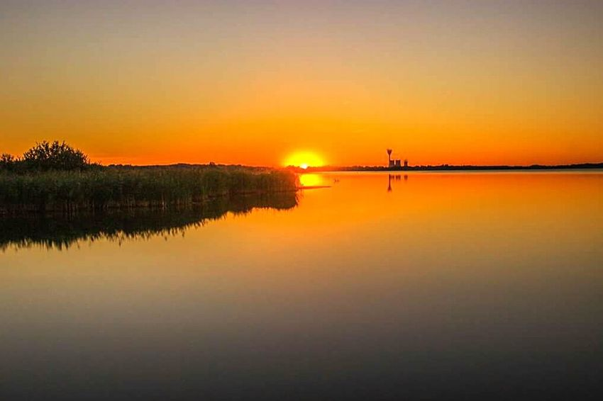 Reflection Sunset Water Travel Symmetry Orange Color Tranquility Nature Lake Idyllic Sky Tree Silhouette Scenics No People Travel Destinations Beauty In Nature Tranquil Scene Reflection Lake Outdoors Nature Photography Langzeitbelichtung Canon600D Landscapephotography Landscape_photography