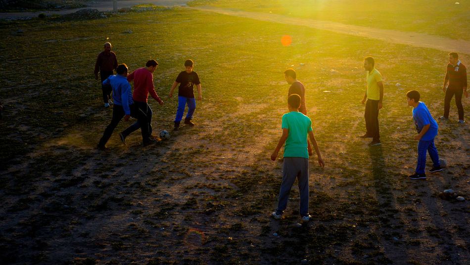 People Playing Football Nature Golden Sunset Golden Light Light Golden View Gorgeous View Check This Out Popular EyeEm Team EyeEm Outdoor Photography Sunset View Hanhing Out People Photography People Playing Shiraz🍷 The Street Photographer - 2016 EyeEm Awards The Great Outdoors With Adobe Football Fever The Photojournalist - 2016 EyeEm Awards The Great Outdoors - 2016 EyeEm Awards EyeEm Diversity Break The Mold Paint The Town Yellow #FREIHEITBERLIN