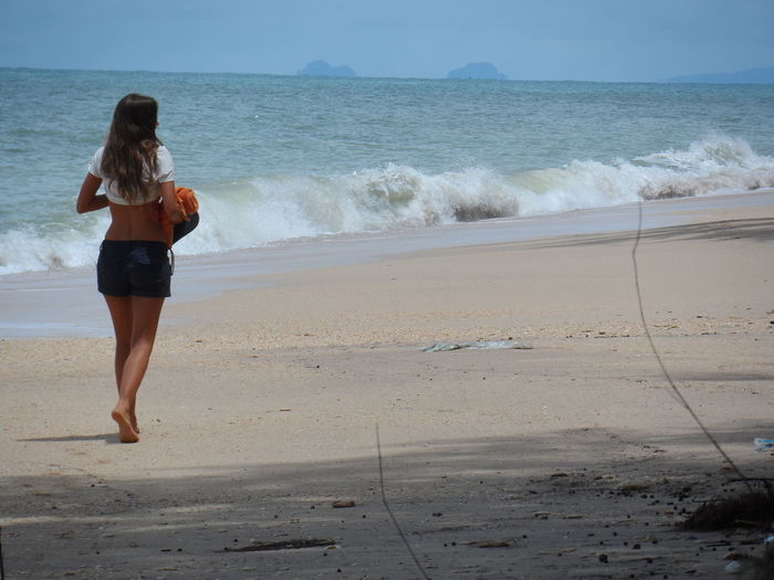 Beach Beauty In Nature Casual Clothing Coastline Horizon Over Water Idyllic Leisure Activity Lifestyles Scenics Sea Shore Standing Tranquil Scene Vacations Water Wave