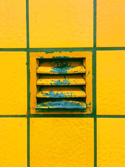 Full frame shot of yellow vent and tiles