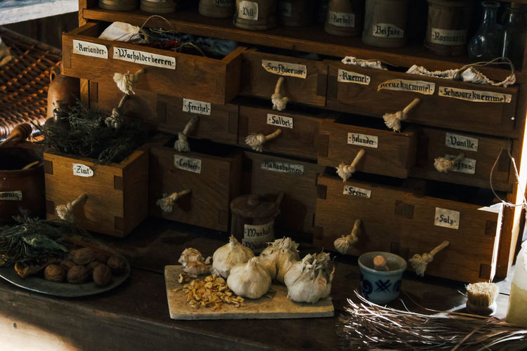 Food And Drink Food Container Large Group Of Objects Indoors  No People Abundance Freshness Retail  Healthy Eating Choice Basket Market Variation Shelf Wellbeing Text For Sale Price Tag Still Life Retail Display Garlic Garlic Bulb Kitchen Spices Herbs Nuts Medieval Medieval Kitchen
