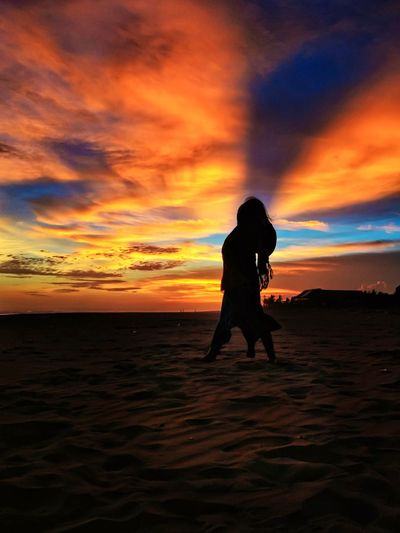 Woman in frame Vitaminsea #sea Beach Beachphotography Sunset Sunset_collection Sunset Silhouettes #bluehour #Goldensunset Woman #womanportrait #sky Full Length Beach Water Multi Colored Sea Silhouette Sand Sand Dune Sun Seascape Romantic Sky