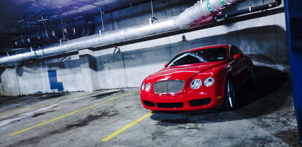 Bentley Luxury Luxury Car Vehicle Automobile Car Red City Land Vehicle Car Architecture Parking Garage Parking Lot Parking Sign Parking Vehicle Light Headlight Stationary