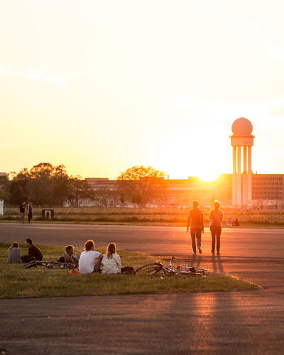 Tempelhof summer Sunset Adult Togetherness People Silhouette Friendship Outdoors Leisure Activity Men Young Men Young Adult Adults Only Lifestyles WomenYoung Women Standing Day Sky Water Berlin Summer The Week On EyeEm