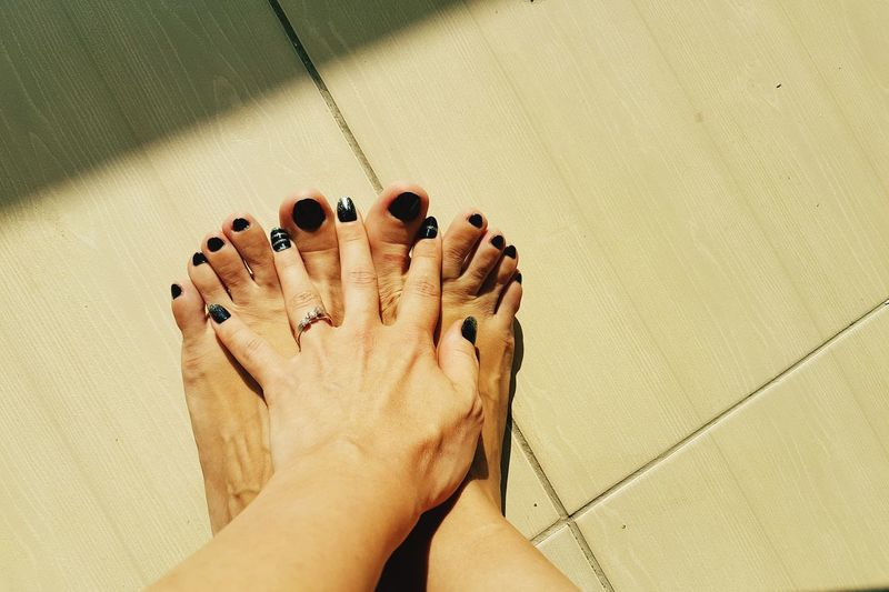 Barefoot Human Foot Low Section Nail Polish Leisure Activity Feet Feetselfie Hand Hands And Feet Touching Skin Tanning Summer Sunlight Manicure Pedicure Black Nailpolish Black Nails Wrinkles Minimalism EyeEmNewHere The Week On EyeEm Lifestyle Fashion&love&beauty Mix Yourself A Good Time Rethink Things Inner Power This Is Aging International Women's Day 2019